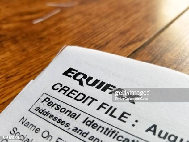 Closeup of the upper corner of a consumer credit report from the credit bureau Equifax with text reading Credit File and Personal Identification on a...