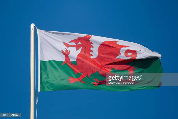 Close-up of the Wales national flag against a blue sky on March 8, 2021 in Cardiff, Wales. The 2021 Senedd election will be the sixth held since...