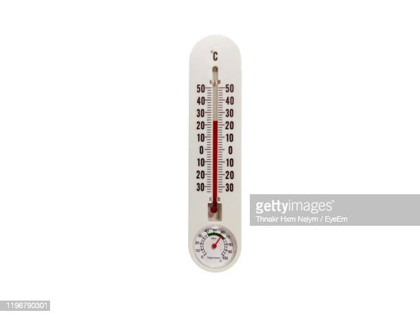 close-up of thermometer against white background - celsius stock pictures, royalty-free photos & images