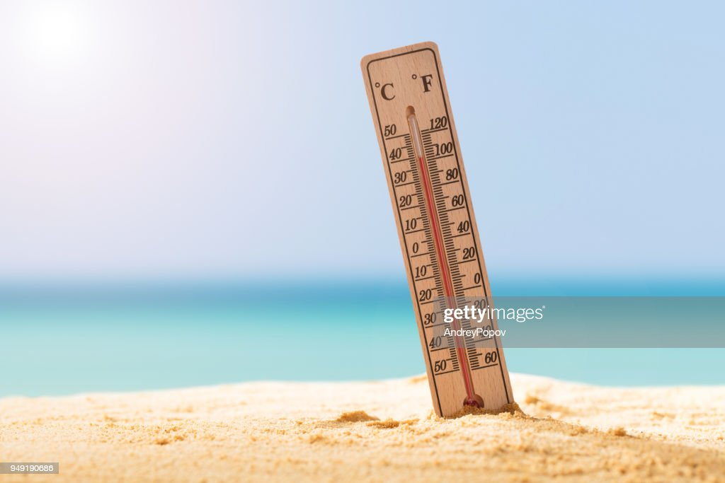 Close-up Of Thermometer On Sand : Stock Photo