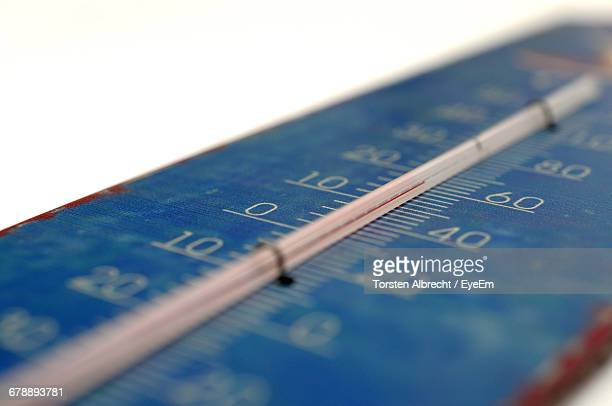 Close-up Of Thermometer On White Background