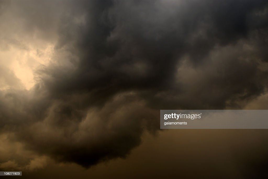 Close-up of thick clouds forming a storm at dusk : Bildbanksbilder