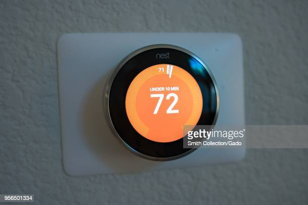 Closeup of third generation Nest Learning Thermostat from Google Inc a smart home thermostat which automatically learns its users' behaviors showing...