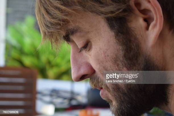 Close-Up Of Thoughtful Bearded Man Looking Down