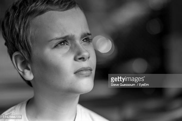 close-up of thoughtful boy - steve guessoum stockfoto's en -beelden