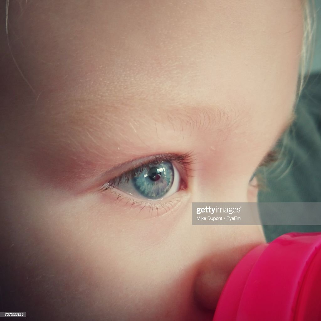 closeup of thoughtful girl with blue eyes ストックフォト getty images