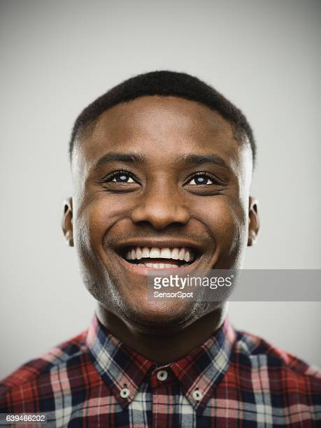 close-up of thoughtful happy man looking up - nigerian men stock photos and pictures