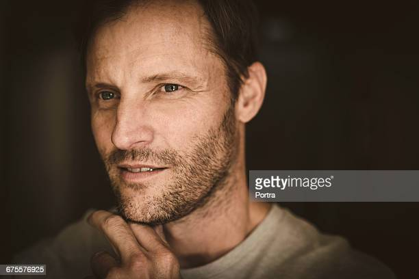 close-up of thoughtful man at home - stubble stock pictures, royalty-free photos & images