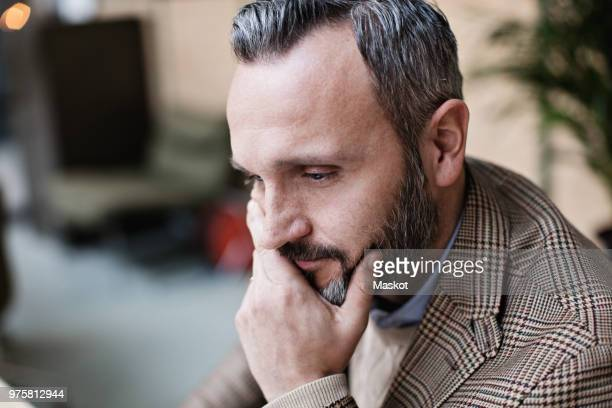 Close-up of thoughtful mature businessman at office