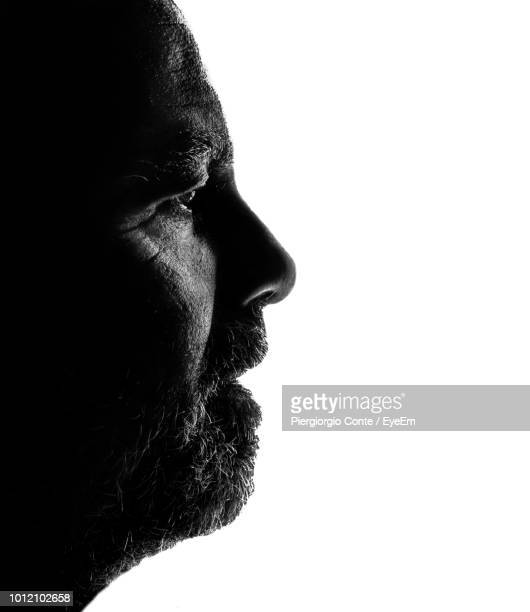 Close-Up Of Thoughtful Mature Man Against White Background