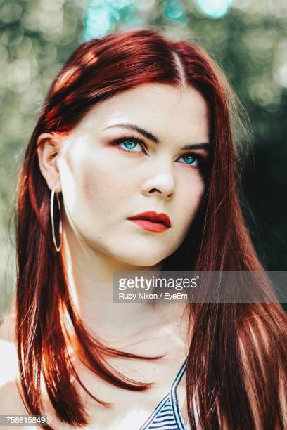 Close-Up Of Thoughtful Redhead Woman Looking Up