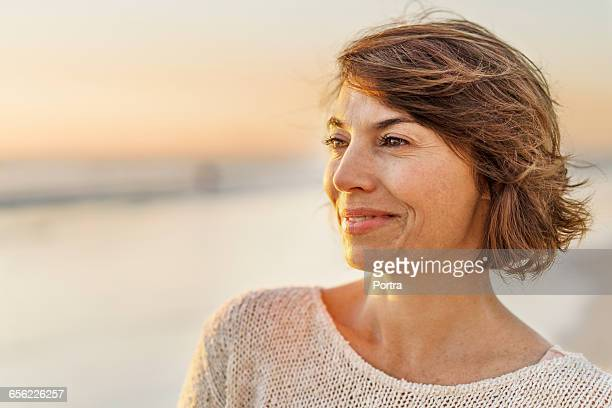 close-up of thoughtful woman at beach - 40 44 years stock pictures, royalty-free photos & images