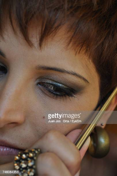 Close-Up Of Thoughtful Woman Holding Metal Rod
