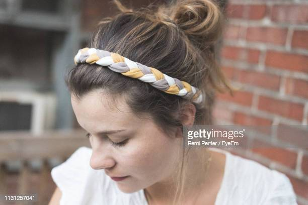 close-up of thoughtful woman - headband stock pictures, royalty-free photos & images