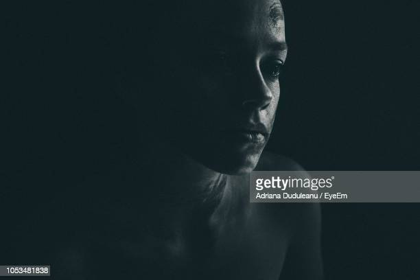 close-up of thoughtful woman with face paint against black background - body paint fotografías e imágenes de stock