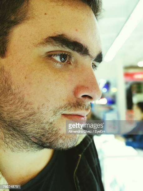 Close-Up Of Thoughtful Young Man In Store