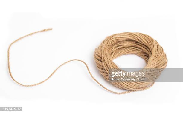 close-up of thread over white background - string stock pictures, royalty-free photos & images