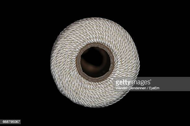 Close-Up Of Thread Spool Against Black Background