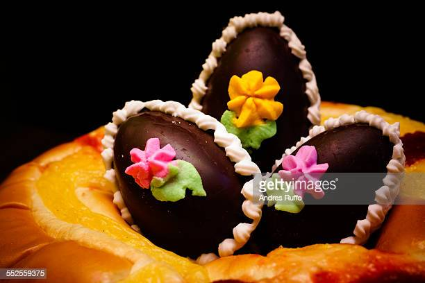 closeup of three chocolate easter eggs, each decor - andres ruffo stock photos and pictures
