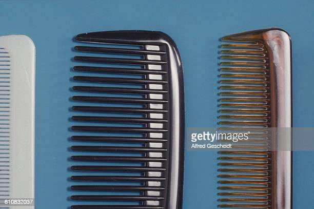 A closeup of three combs 1988