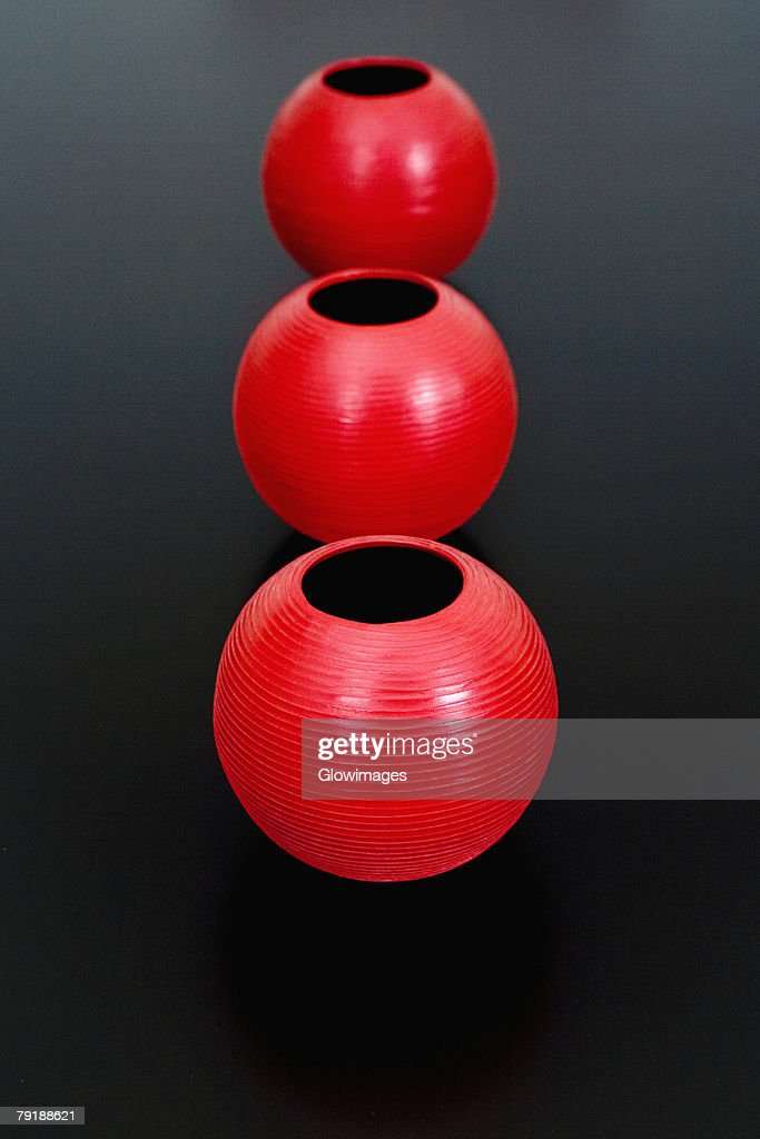 Close-up of three decorative urns in a row : Stock Photo