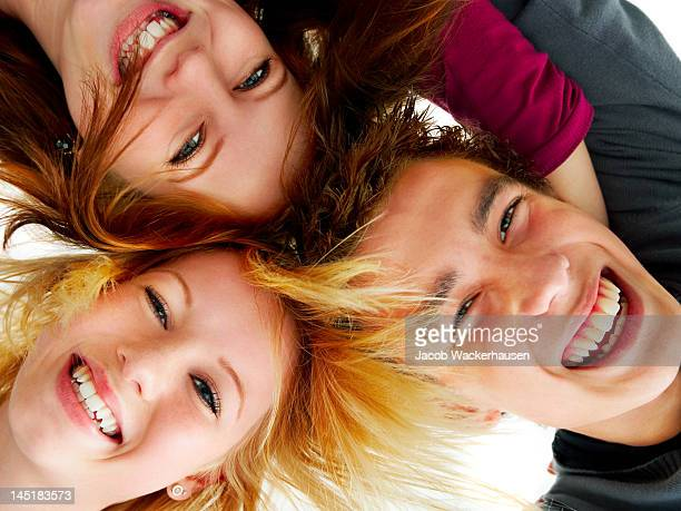 Close-up of three friends smiling