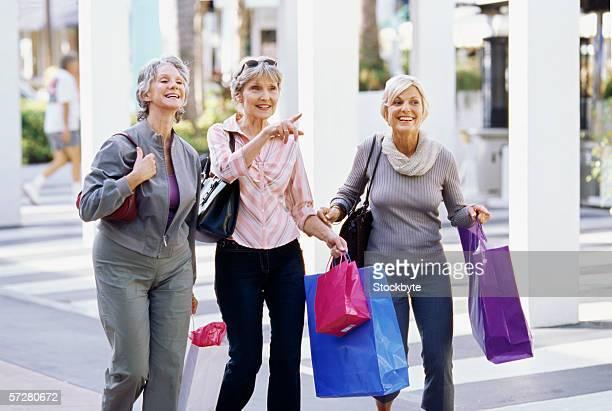 Close-up of three mature women walking and talking