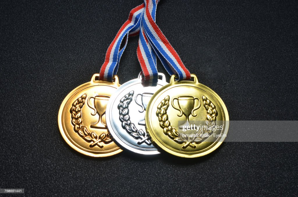 Close-Up Of Three Medals Against Black Background : Stock Photo