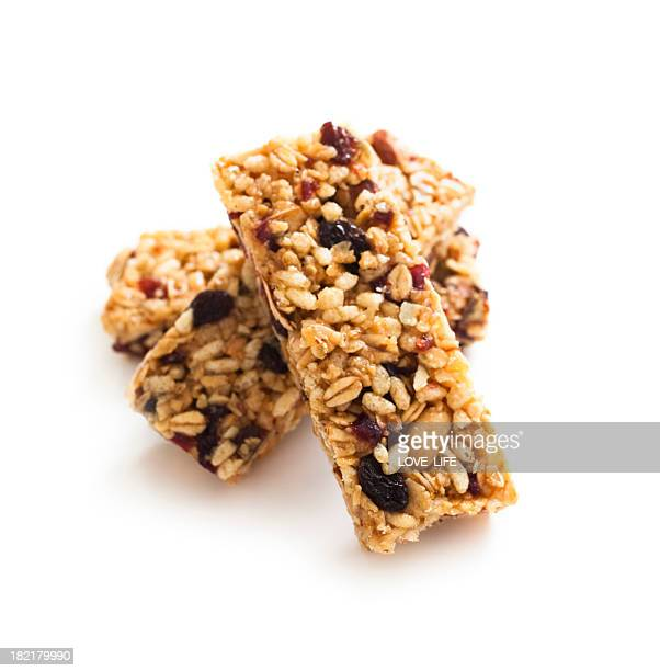 Close-up of three stacked granola protein bars
