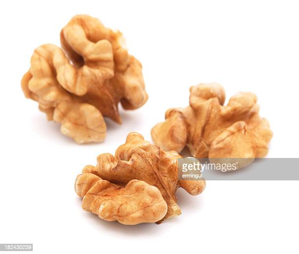 Close-up of three walnuts on a white background