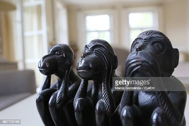 close-up of three wise monkey statues - see no evil hear no evil speak no evil stock pictures, royalty-free photos & images