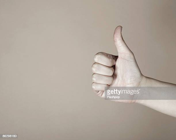Close-up of thumbs up