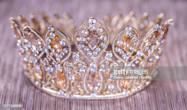 close-up of tiara on table - crown close up stock pictures, royalty-free photos & images