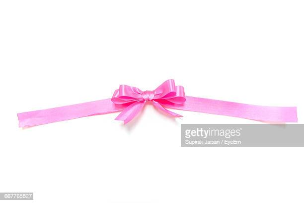 Close-Up Of Tied Bow Ribbon On White Background