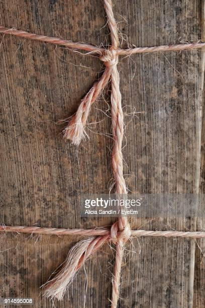 Close-Up Of Tied Rope On Wood
