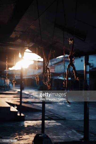 close-up of tied ropes hanging on roof - west kalimantan stock pictures, royalty-free photos & images
