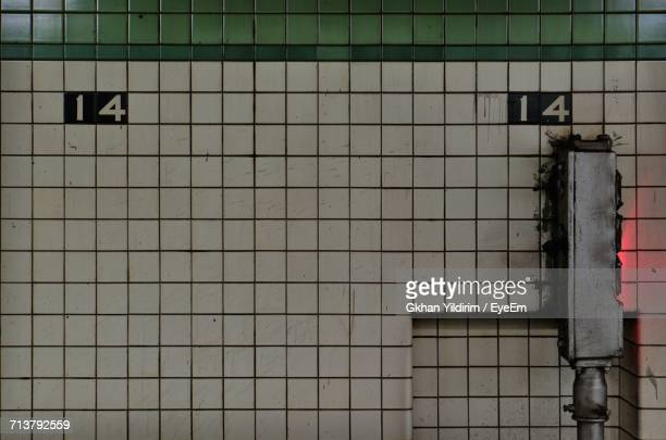 close-up of tiled wall - new york city subway stock pictures, royalty-free photos & images