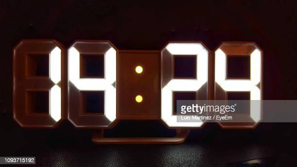 close-up of time - digital clock stock photos and pictures