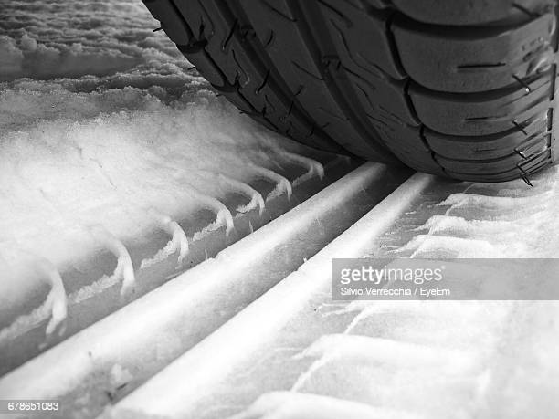 Close-Up Of Tire On Snow