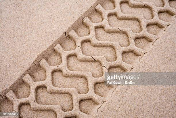 Close-Up Of Tire Track In Sand
