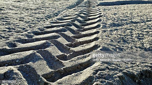 Close-Up Of Tire Track On Sand