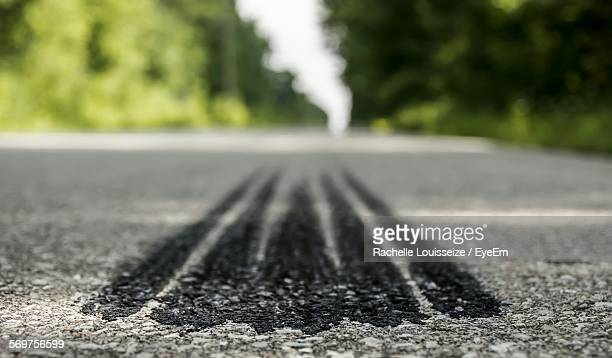 Close-Up Of Tire Tracks On Road