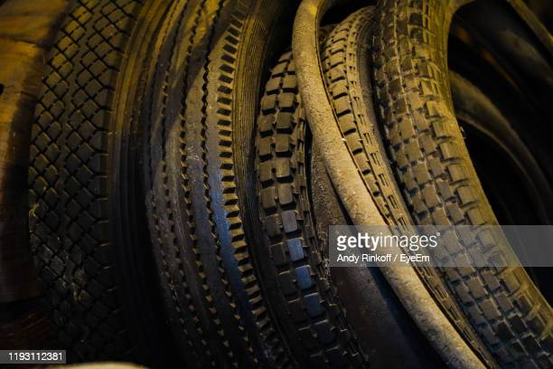 close-up of tires in workshop - andy rinkoff stock pictures, royalty-free photos & images