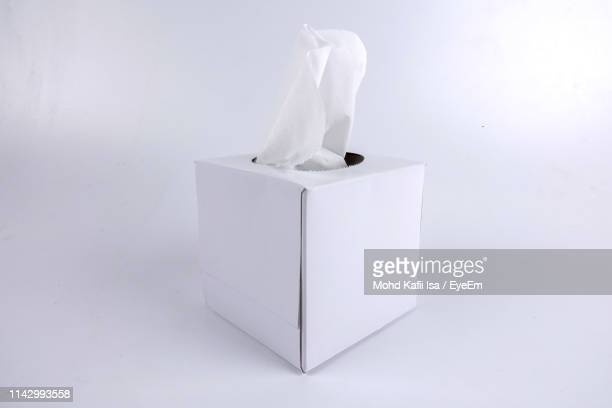 close-up of tissue paper in box over white background - handkerchief - fotografias e filmes do acervo