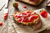 Close-up of toast with homemade strawberry jam on table