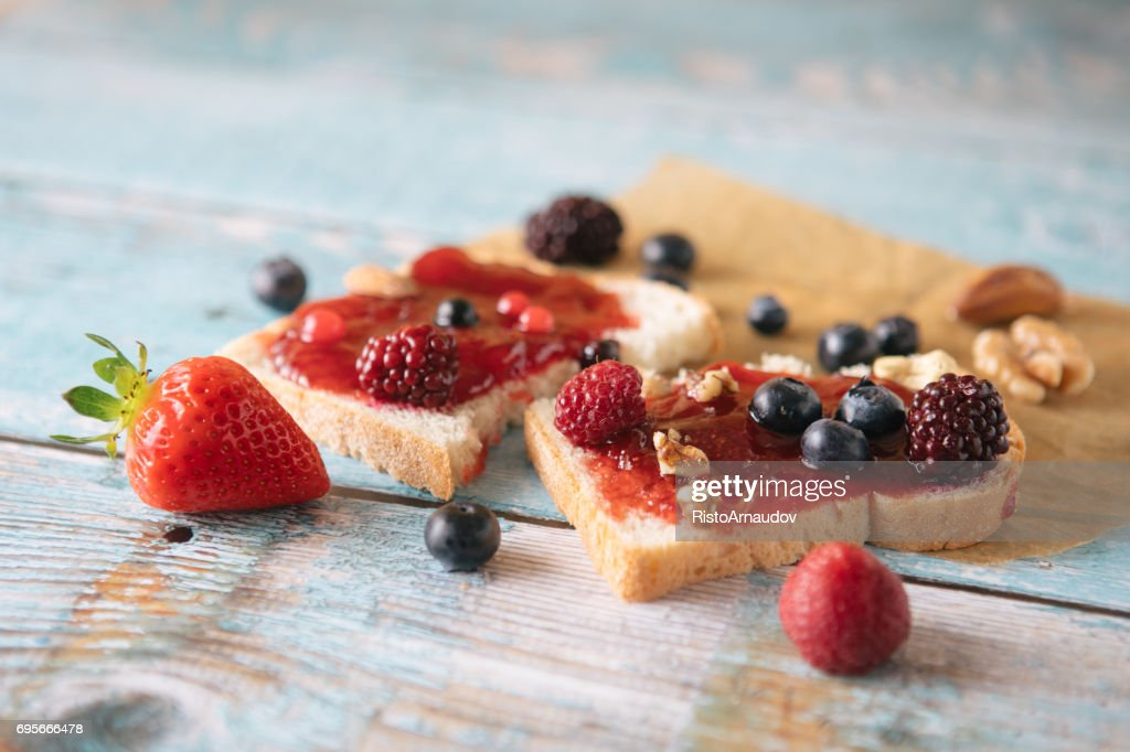 Close-up of toast with homemade strawberry jam on table - Stock image... : Stock Photo