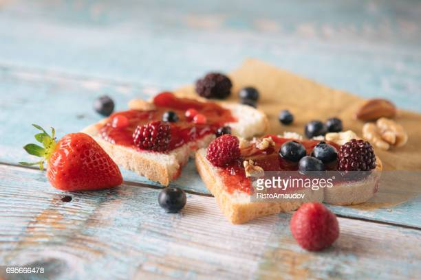 close-up of toast with homemade strawberry jam on table - stock image... - jam stock pictures, royalty-free photos & images