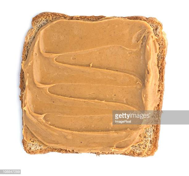 Close-up of toast with thick layer of smooth peanut butter