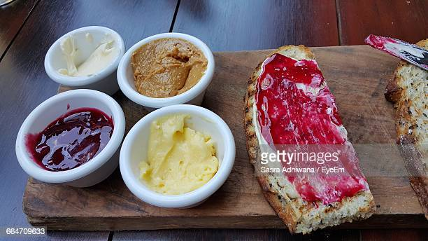 Close-Up Of Toast With Various Dips