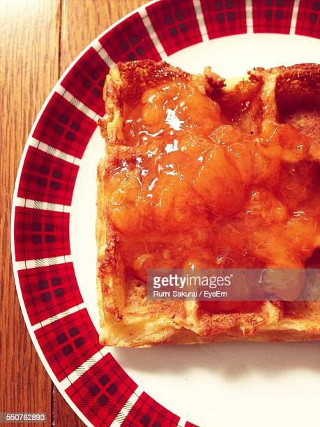 Close-Up Of Toasted Bread On Marmalade In Plate